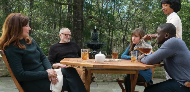 Chris sits down for tea with Rose's parents in Get Out. (From left, Catherine Keener, Bradley Whitford, Allison Williams, Betty Gabriel and Daniel Kaluuya).
