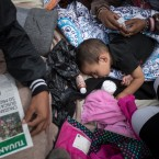 A two-year-old child from Honduras gets treatment for an ear infection after sleeping in the open in front of the El Chaparral port of entry, in Tijuana, Mexico, Monday, April 30, 2018. About 200 people in a caravan of Central American asylum seekers waited on the Mexican border with San Diego for a second straight day on Monday to turn themselves in to U.S. border inspectors, who said the nation's busiest crossing facility did not have enough space to accommodate them.