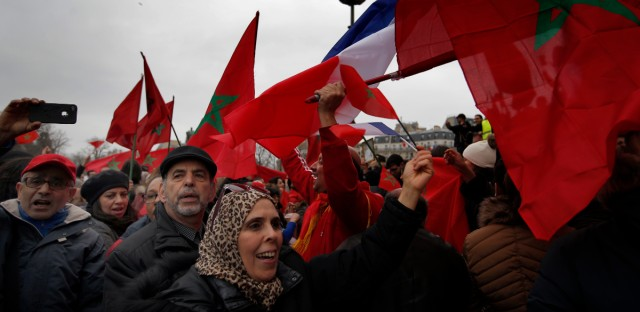Demonstrators wave Moroccan flags during a protest in Paris, Sunday, March 20, 2016. The United States is declaring its support for the threatened U.N. peacekeeping mission in the disputed territory of Western Sahara after Morocco took steps to reduce its size and terminate $3 million in funding.