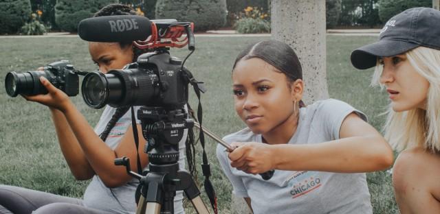 High school filmmaker Antoinette Green works with her graduate student mentor, Alina Slovachevska.