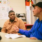 Jim Courtney-Clarks, 15, talks with Army veteran Alberto Bóleros during the Urban Warriors program in December 2015. The Chicago program is designed to bring together veterans and youth who have been exposed to the city's violence.