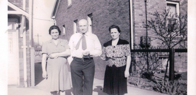 Chet Szerlag's father Frank, center, stands with his wife Anna, right, and his sister Marya, left, at home in Detroit.
