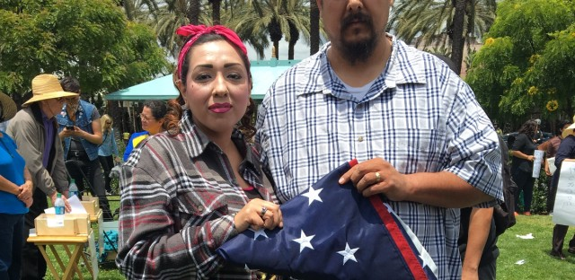 "At a recent anti-Donald Trump protest in Anaheim, California, this couple said they saved the U.S. flag from a Trump supporter who was trying to get Latinos to trample it. Nervous about giving their full names, he said his was Anthony, and she said she was going by ""America."""