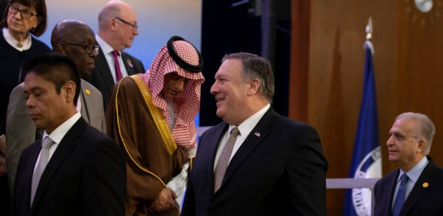Secretary of State Mike Pompeo, center, walks past Saudi Arabia's Foreign Minister Adel al-Jubeir, as he and other foreign ministers arrive before a family photo during the Global Coalition to Defeat ISIS meeting, at the State Department, Wednesday, Feb. 6, 2019, in Washington.
