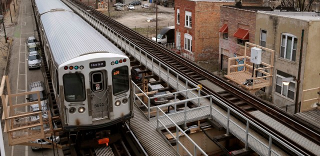 A Chicago Transit Authority Green Line train travels West away from downtown Chicago in March.