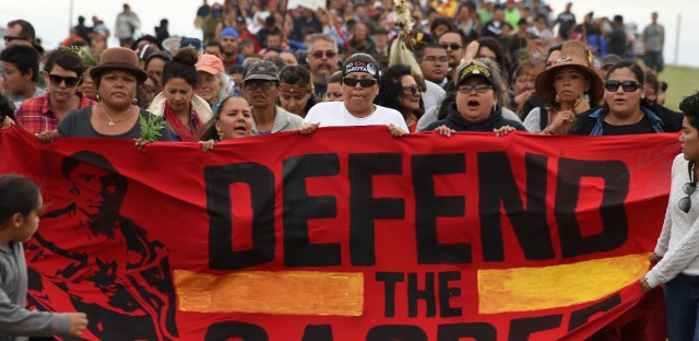 Native Americans march to a sacred site on Sunday that they say was disturbed by bulldozers working on the Dakota Access Pipeline, near the encampment where hundreds of people have gathered to join the Standing Rock Sioux Tribe's protest.