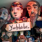 A collection of oversize puppet heads and smaller puppets in the Y No Había Luz studio.