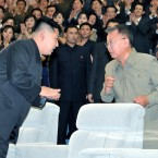 The late North Korean leader Kim Jong Il, right, exchanges words with his son and successor, Kim Jong Un, in July 2011. The elder Kim died in December 2011.