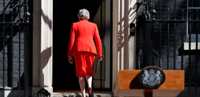 British Prime Minister Theresa May walks away after making a speech in the street outside 10 Downing Street in London, England, Friday, May 24, 2019. Theresa May says she'll quit as UK Conservative leader on June 7, sparking contest for Britain's next prime minister.