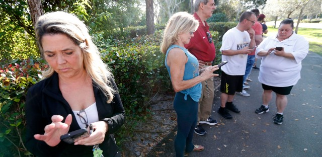 Anxious family members wait for information on students.
