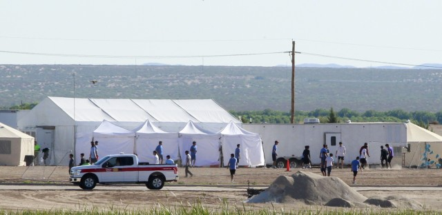 The Pentagon plans to build temporary camps for detained immigrants. Here, children of detained migrants are seen at a tent encampment near the U.S. Customs and Border Protection port of entry in Tornillo, Texas.