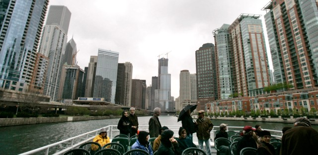 Passengers take in the sights as they head east down the Chicago River during an architectural boat tour of Chicago Saturday, May 3, 2008.