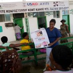 A nurse informs women about cancer at the Saint Nicolas Hospital, during the comprehensive cervical cancer initiative in Saint-Marc, Haiti, Wednesday, Dec. 2, 2015.