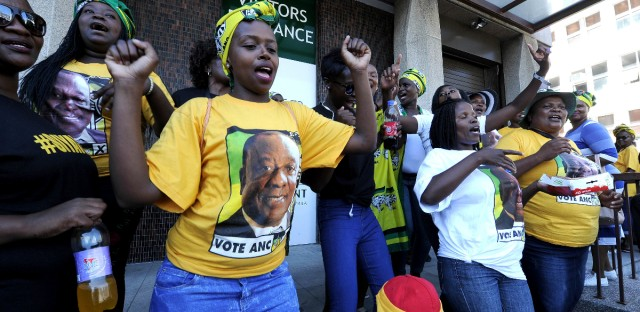 Supporters for president elect Cyril Ramaphosa, portrait on t-shirt, sing and dance outside in Cape Town, South Africa, Thursday, Feb. 15, 2018. Cyril Ramaphosa on Thursday was elected as South Africa's new president by ruling party legislators after the resignation of Jacob Zuma, whose scandals brought the storied African National Congress to its weakest point since taking power at the end of apartheid.