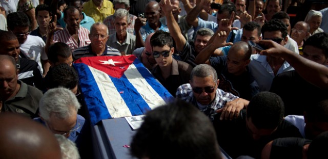 Friends and family of the late Cuban activist Oswaldo Paya carry his flag draped coffin during his burial at a cemetery in Havana Tuesday. Paya, 60, gained international fame as the lead organizer of the Varela Project, a signature-gathering drive asking authorities for a referendum on guaranteeing rights such as freedom of speech and assembly.