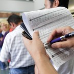 People fill out forms in which they can register as an organ and tissue donor as they apply for a California drivers license at a DMV in Los Angeles in July 2011. (AP Photo/Nick Ut)