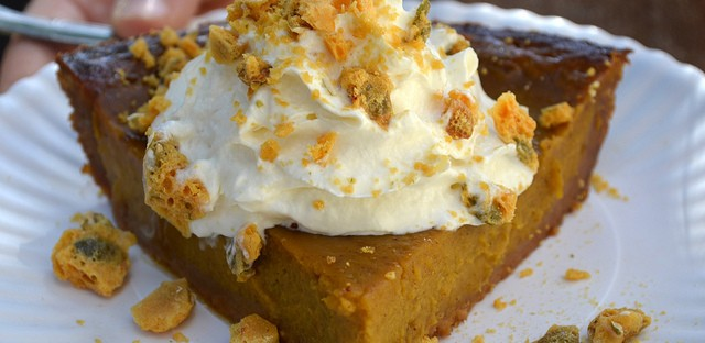 Pumpkin pie with pumpkin seed brittle and whipped cream in a graham cracker crust at Bang Bang Pie Shop