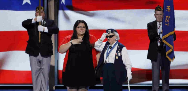 Clarissa Rodriguez of Texas, 17, and Ruby Gilliam of Ohio, 93, deliver the Pledge of Allegiance during the first day of the Democratic National Convention in Philadelphia on Monday. They are the youngest and oldest delegates at the convention.