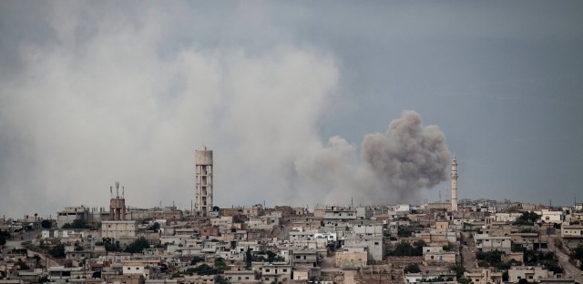 In this Sept. 19, 2013, file photo, smoke rises after a TNT bomb was thrown from a helicopter, hitting a rebel position during heavy fighting between troops loyal to president Bashar Assad and opposition fighters, in a neighbouring village to Kafr Nabuda, in the Idlib province countryside, Syria. The campaign for Idlib, the opposition's only remaining stronghold in the country and now a refuge for over one million displaced Syrians, is likely to be the last major theater of battle after seven years of brutal civil war.