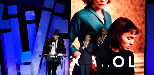 "Ed Lachman accepts the award for best cinematography for ""Carol"" at the Film Independent Spirit Awards on Saturday, Feb. 27, 2016, in Santa Monica, Calif. Ken Jeong, left, and Keegan-Michael Key look on from right."