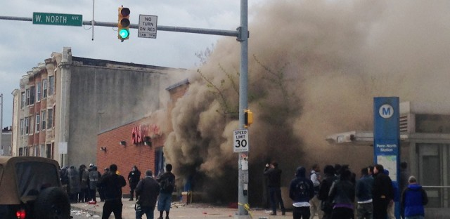 Smoke billows from a CVS Pharmacy store in Baltimore on April 27. Demonstrators clashed with police after the funeral of Freddie Gray, who died from spinal injuries about a week after he was arrested and transported in a Baltimore Police Department van.