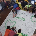 Stagg High School students sign a banner pledging to say something.