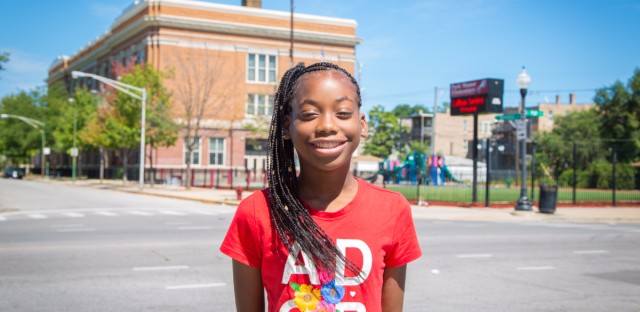 "Da'Nasia Lewis, 11, was one of the first in line for free back-to-school braids. ""I feel beautiful!"" she said. She's in the sixth grade at Washington Elementary in Riverdale, Illinois."