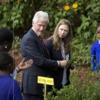 Former President Bill Clinton and daughter Chelsea Clinton tour a primary school's garden in Nairobi last year as part of a tour of the Clinton Foundation's projects in Kenya.