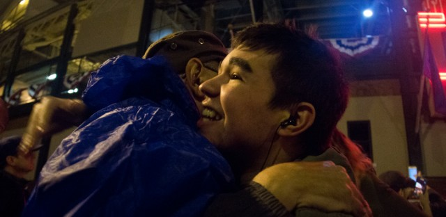 An embrace outside Wrigley Field after the Cubs won Game 7 of the World Series 8-7 in Cleveland. Andrew Gill/WBEZ