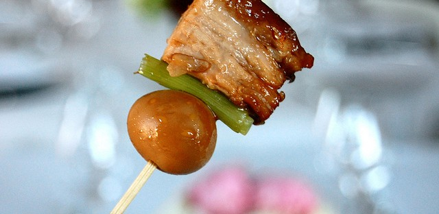 Braised pork belly with quail egg