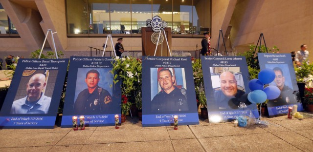 Portraits of the five murdered Dallas police officers sit in front city hall.