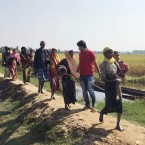 In this Nov. 22, 2016 photo supplied by Amnesty International, Rohingya refugees cross the border into Bangladesh close to Whaikyang in Cox's Bazar District, Southeastern Bangladesh. The actions of Myanmar's military may constitute crimes against humanity, human rights group Amnesty International has warned, based on accounts of violence against the country's Muslim Rohingya minority.