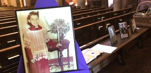 A photo on display of Cardinal Francis George from when he was an altar boy at St Pascal's Church in Portage Park.