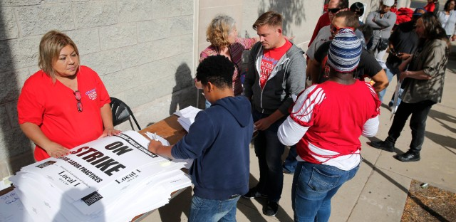 Chicago Teachers Union members pick up strike material outside union's strike headquarters Monday, Oct. 10, 2016, in Chicago. Negotiators for the union and Chicago Public Schools reached a late-night, tentative deal Monday night to avert a threatened teachers' strike.
