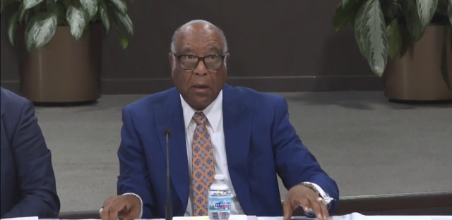 Chicago Housing Authority Board Chairman John Hooker speaks at Tuesday's board meeting.