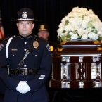Simi Valley police stand guard as people pay their respects as former first lady Nancy Reagan lies in repose at the Ronald Reagan Presidential Library March 10, 2016 in Simi Valley, California. Reagan died of heart failure at the age of 94. (Mike Blake/Getty Images)
