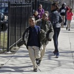 In this April 3, 2013 photo, children leave Dvorak Technology Academy in Chicago at the end of classes.