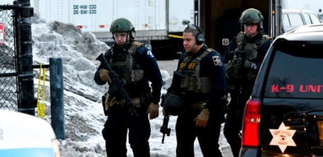 Law enforcement officers work at the scene of a shooting at the Henry Pratt Co. on Friday, Feb. 15, 2019, in Aurora, Ill. Officials say several people were killed and at least five police officers were wounded after a gunman opened fire in an industrial park.