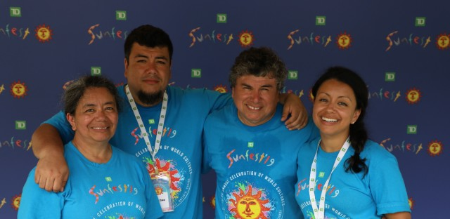 Alfredo Caxaj (second from right) came to Canada from Guatemala with his wife and son in 1985. Now his daughter Mercedes (right) runs the family business — TD Sunfest -— one of the biggest world music festivals in North America.