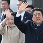 Japan's Prime Minister Shinzo Abe and his wife Akie Abe wave as Emperor Akihito and Empress Michiko depart for Vietnam from the Haneda International Airport in Tokyo, Tuesday, Feb. 28, 2017.