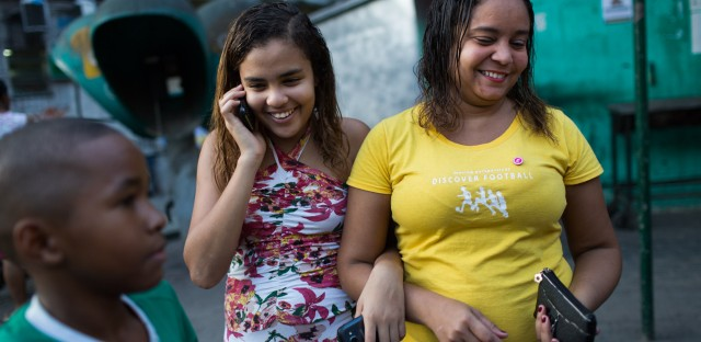 Lala's mother, Thais (right), is a Brazilian soccer mom, present at all her daughter's games.