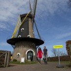 Voters leave the Kerkhovense Molen, a windmill turned polling station in Oisterwijk, south central Netherlands, Wednesday. Local media are reporting high turnout in the country's national elections.