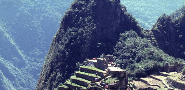Panoramic view of the the Inca citadel of Machu Picchu in Cusco Located atop a craggy peak in Peru's jungle-covered southern Andes, 310 miles (500 kilometers) southeast of Lima, Peru in this July, 1995, photo.