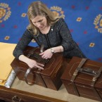 Connecticut is the latest state to pledge its electoral votes based on the outcome of the national popular cote. Here, an aide opens Electoral College ballot boxes during a joint session of Congress in January of 2016, to tally ballots for the president and vice president of the United States. Tom Williams/CQ-Roll Call,Inc.