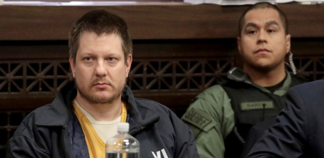 In this Dec. 14, 2018, file photo, former Chicago police Officer Jason Van Dyke, left, appears for a hearing at the Leighton Criminal Court Building, in Chicago. Attorneys in the case of the former Chicago police officer convicted of second-degree murder and 16 counts of aggravated battery in the 2014 shooting death of black teenager Laquan McDonald are making their final arguments to a judge who will impose the sentence the week of Jan. 14, 2019.