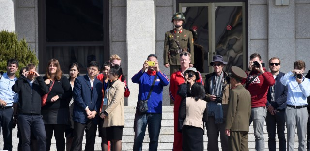 Visitors take a look from North Korean side while U.S. Defense Secretary Jim Mattis and South Korean Defense Minister Song Young-moo visit the truce village of Panmunjom in the Demilitarized Zone (DMZ) on the border between North and South Korea Friday, Oct. 27, 2017.