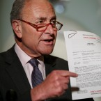 Senate Minority Leader Sen. Chuck Schumer of N.Y. points to a copy of a White House released rough transcript of a phone call between President Donald Trump and the President of Ukraine, as Schumer speaks to the media about an impeachment inquiry on President Trump, Wednesday Sept. 25, 2019, on Capitol Hill in Washington.