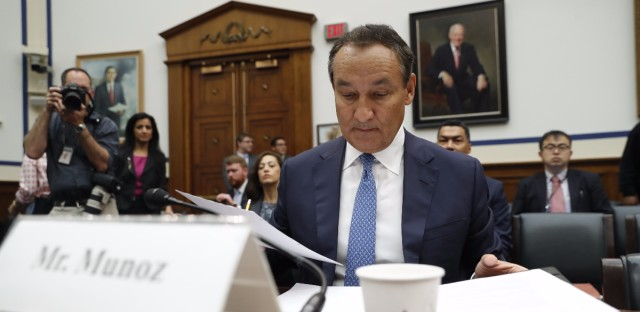 United Airlines CEO Oscar Munoz prepares to testify on Capitol Hill in Washington on May 2, 2017, before a House Transportation Committee oversight hearing.