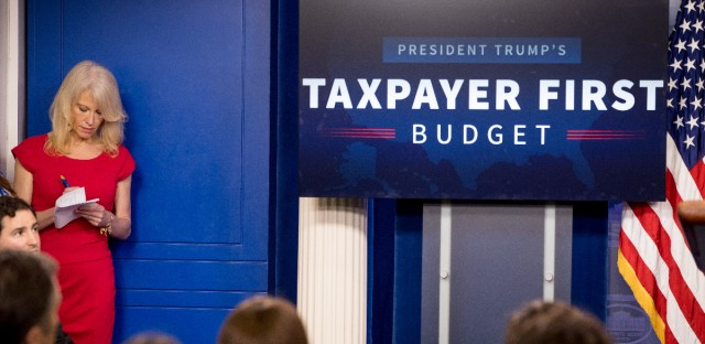 Counselor to the President Kellyanne Conway listens as Budget Director Mick Mulvaney speak to the media about President Donald Trump's proposed fiscal 2018 federal budget in the Press Briefing Room at the White House in Washington on May 23, 2017.