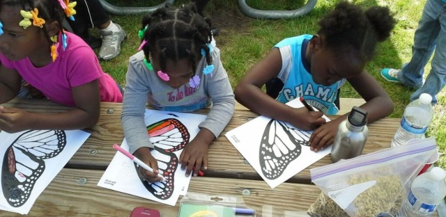Students in the Sacred Keepers Sustainability Lab learning about butterflies on an excursion.